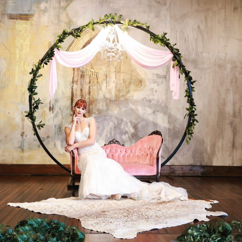 Bride on a couch in an abstract industrial background