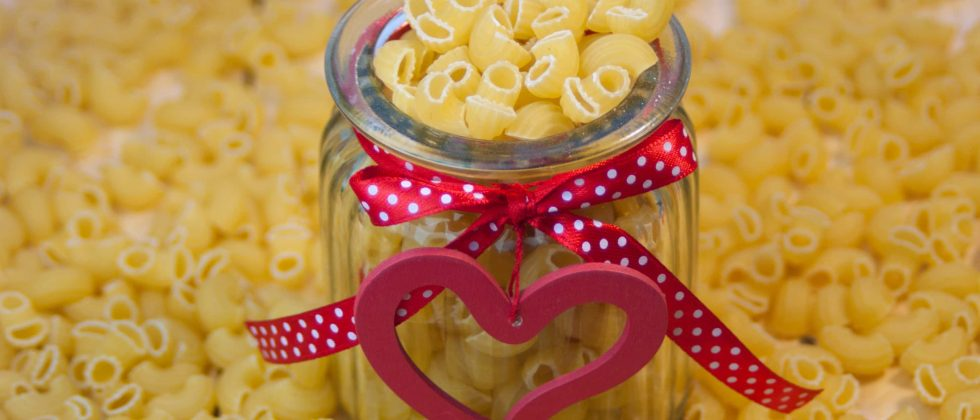 Pasta jar with a bow and wooden heart