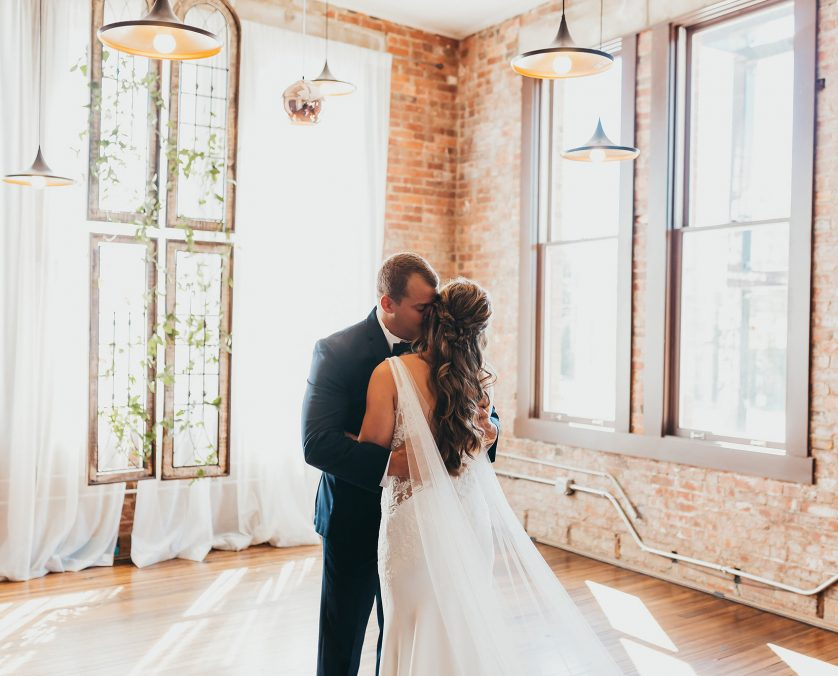 A Bride and Groom Embrace after a first look in the Washington Room