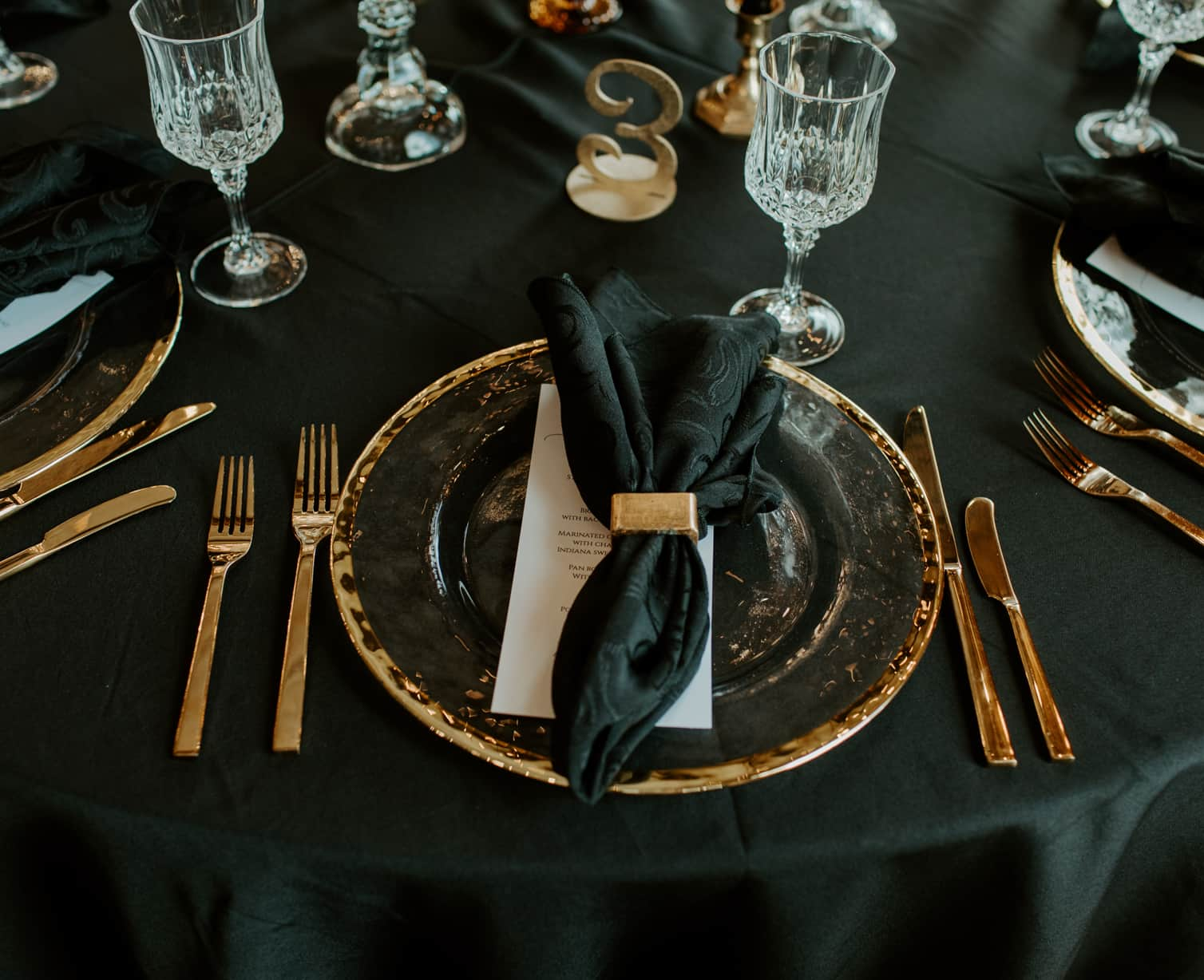 A beautiful table set with black and gold accent at an Indianapolis event