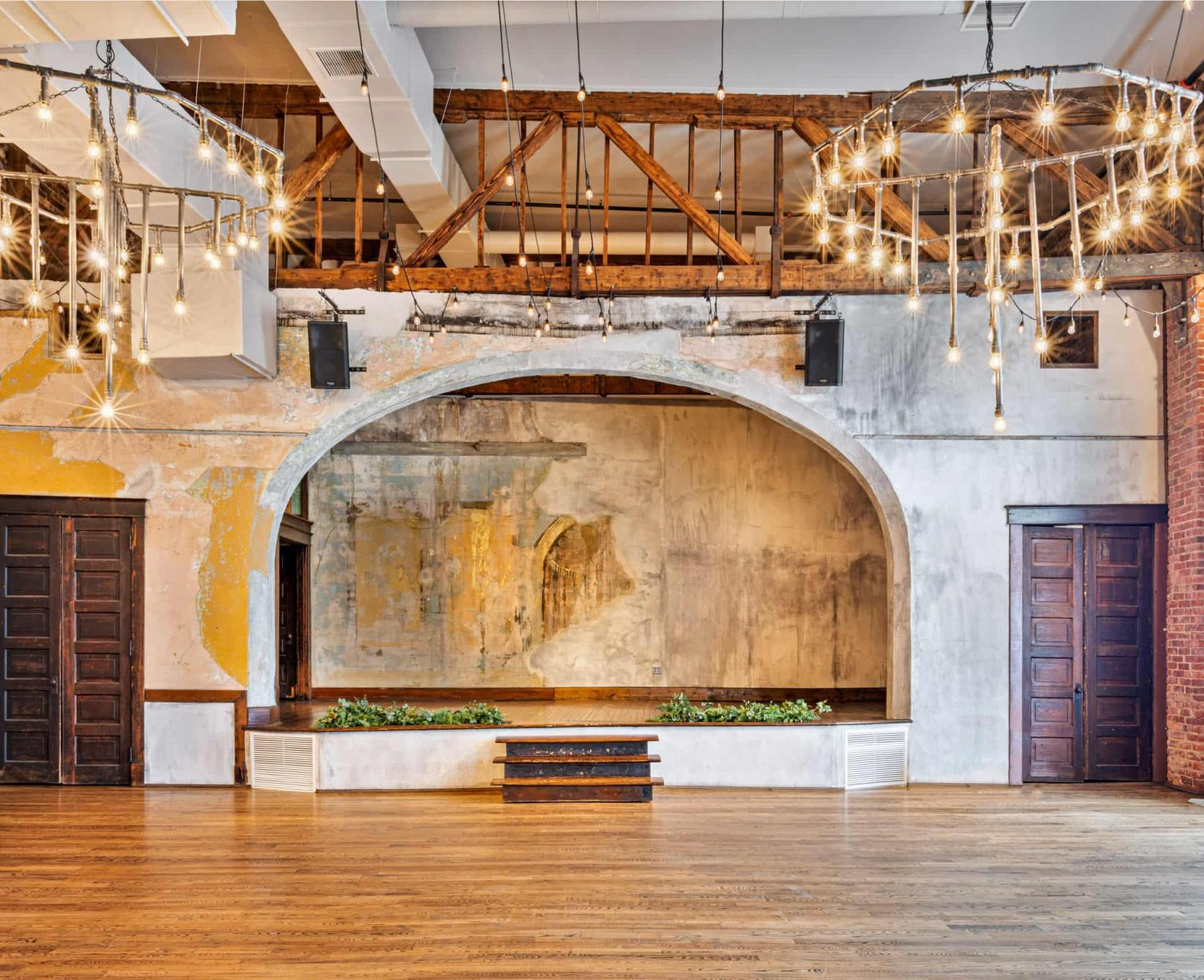 The Grand Hamilton Theater with its high ceilings and large windows fill the space with ample natural light