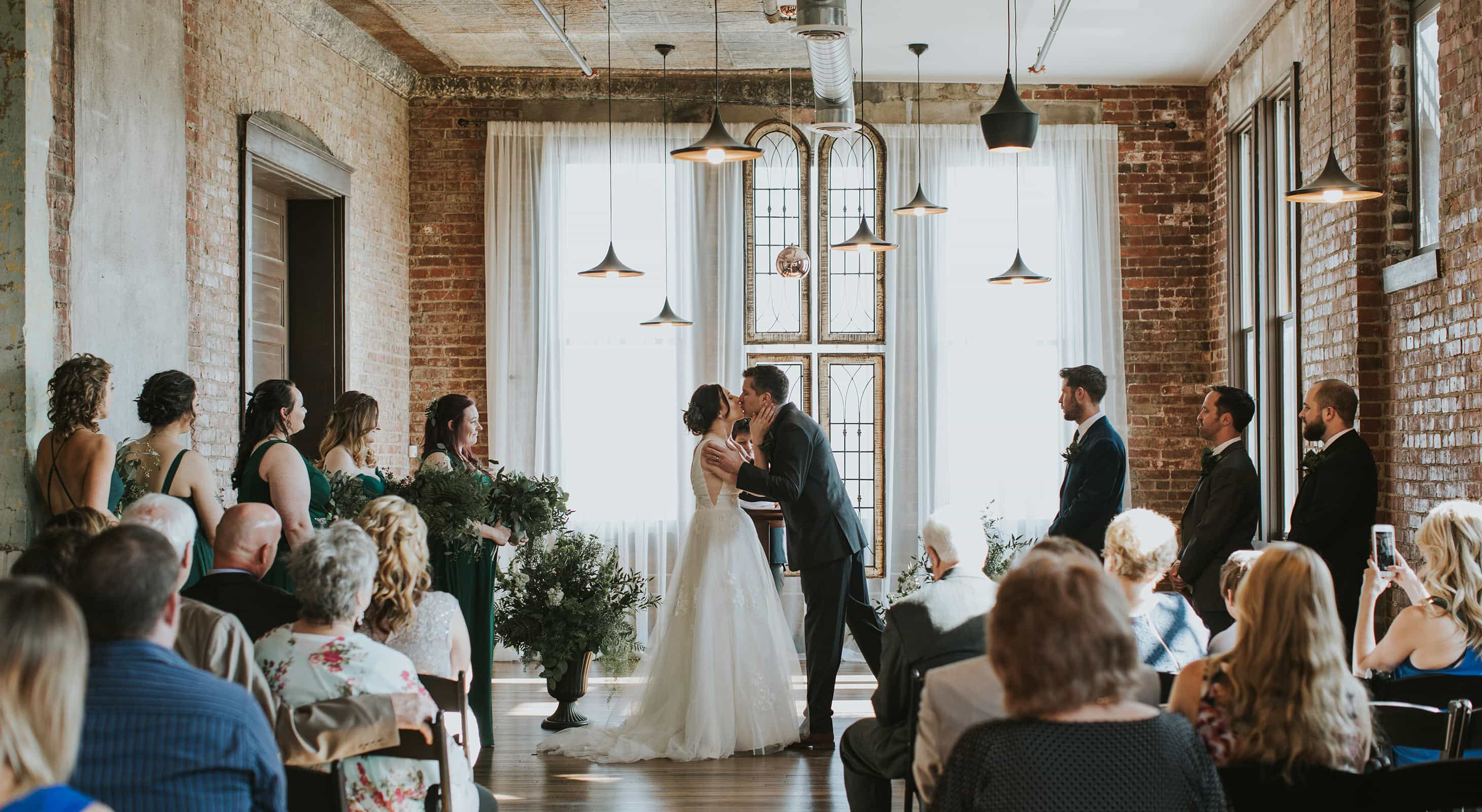 Bride and Groom First Kiss during wedding ceremony