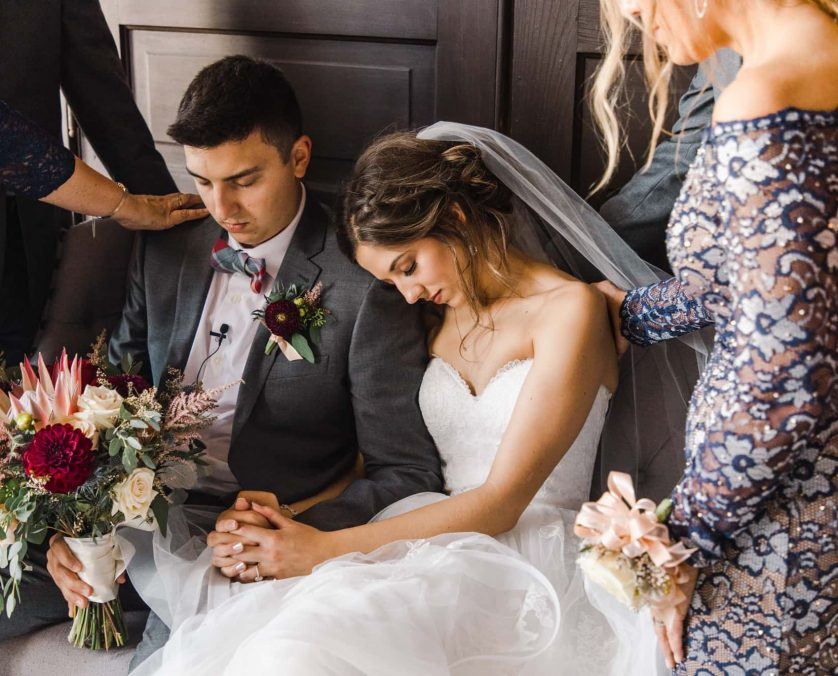 Bride and groom in prayer