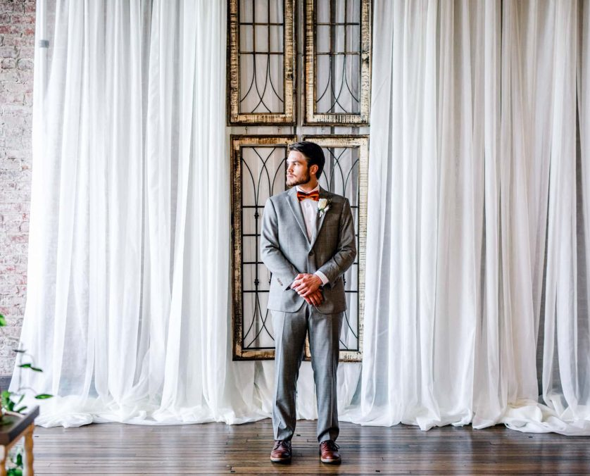 Groom waits patiently for his bride at an Indianapolis wedding venue
