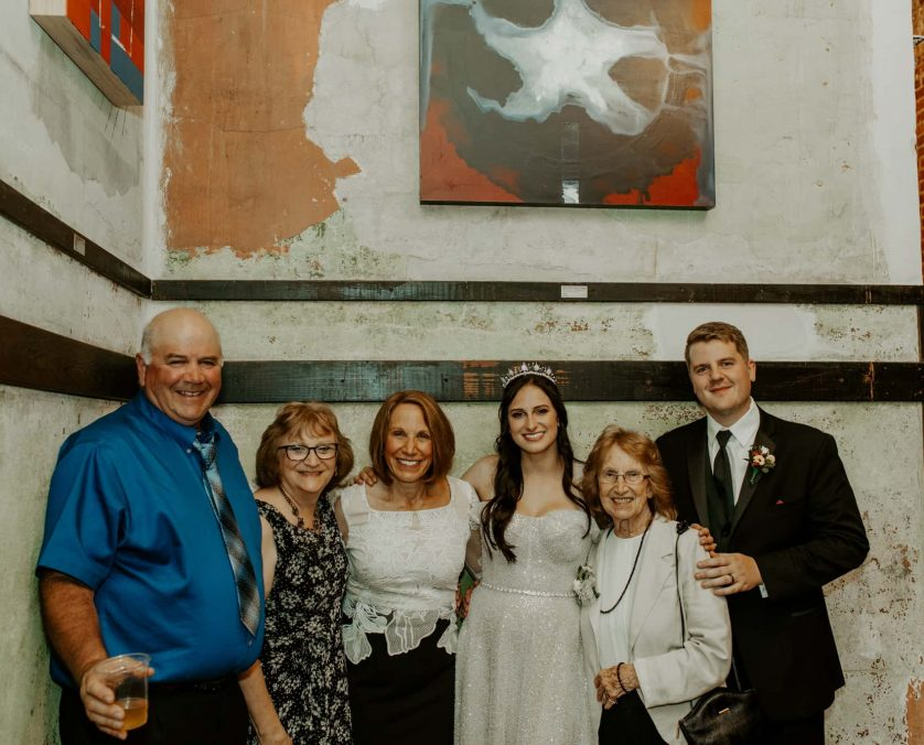 A family poses at an Indianapolis wedding venue